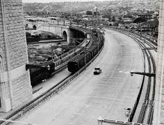 Sydney Harbour Bridge approach in 1932 looking north over the North Shore with the trains on the left and tram tracks on the right. Old Pictures, Old Photos, Over The Bridge, Arch Bridge, Historical Images, Sydney Australia, North Shore, Sydney Harbour Bridge, Faded Glory