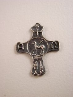 NEW this is very unique solid sterling silver . Nearing the center of the cross, humanity enters eternity where one partakes in the life of Christ, the Paschal Lamb, the Alpha and Omega of our lives and of all creation. We are guided by the spirit and nurtured by Holy Communion. From our beginning to our end, this is the truth to which we consecrate our lives. Revelation 5:5-6 Then one of the elders said to me, Do not weep! See, the Lion of the tribe of Judah, the Root of David, has t...