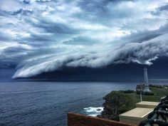 "Last week a cloud formation that look like some kind of ""Tsunami Cloud"" rolled over Sydney and made their citizen dropping their jaws. Technically this is a massive shelf cloud that is stretching several kilometers across the sky..   Read more: http://www.wherecoolthingshappen.com/jaw-dropping-tsunami-cloud-rolls-over-sydney/#ixzz3rD5XcHdM-cloud-tsunami-wcth02"