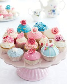 Perfect pastel cupcakes are the focal point on a table for tea.