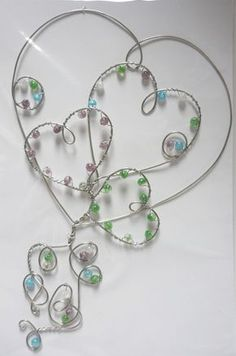 Hearts - beaded silvertone wire hanging design