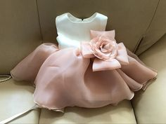 Nothing makes us happier than seeing our beautiful pieces nestled perfectly into our customers' homes--- Made To Order High Quality Off White & Brown Big Flower Sash Belt Baby Girl Party Dress  Available from 3 month until 12 years old  #bigbowflowergirldress #flowergirldresses #babygirlbirthdayoutfit