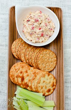 Zippy Southern Pimento Cheese Spread. with garlic  Ingredients: 8 oz. cream cheese 3/4 cup mayonnaise 1 very small clove garlic, minced 1 Tb. chopped onion 1 Tb. Worcestershire sauce 1 Tb. hot sauce 8 oz. shredded extra sharp cheddar (2 cups) 8 oz. shredded pepper jack cheese (2 cups) 1/3 cup chopped pimentos, drained Pepper