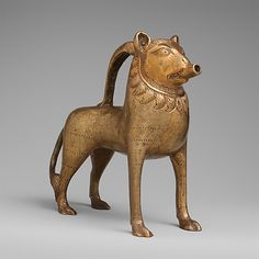 Aquamanile, Lion, 14th century german.  Copper alloy.  I just love these little jugs.
