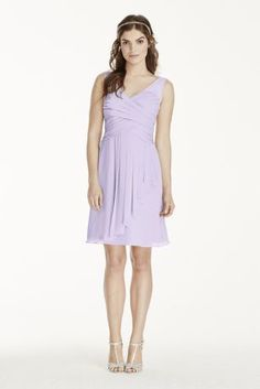 This short illusion tank dress will look stunning on your entire bridal party!  Crinkle chiffon dress features illusion tank straps on a sweetheart neckline pleated bodice.  Short skirt with cascading detail at the front adds movement.  Fully lined. 100%polyester. Back zipper. Dry clean only.  Also available in Extra Length as Style 2XLW10844.