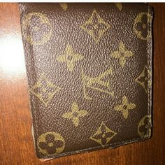 Brown monogram unisex wallet REPOSH! Just light use. Cannot prove authentic, reposhing this. Just don't need it. :) fully  functional. Open to offers. Final sale, no pp, trades. Bags Wallets