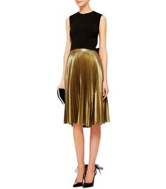 6df1ffb4cc The Only Holiday Skirt You Need, According to Vogue via @WhoWhatWear Gold  Skirt Outfit