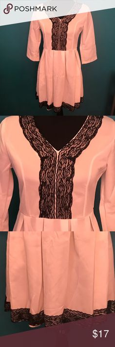 Xinyiyfang brand dress, white with black trim. EUC This is an awesome dress for any occasion. It's white with black lace trim on the bottom and in the middle of the top. It's a size medium, 3/4 length sleeves, and in great condition. xinyiyfang Dresses Mini