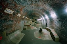 Subway tunnel skate park.