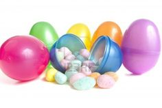Vibrant plastic easter eggs and pastel easter egg candies Stock Photo