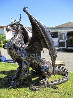 DIY Steampunk Dragon Made from Recycled Car Parts - http://diyforlife.com/diy-steampunk-dragon-made-recycled-car-parts/ - #Dragon, #Recycled, #Steampunk