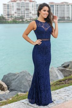 4d7ab797cae1c Buy this pretty Navy High Neck Lace Maxi Dress from Saved by the Dress  Boutique. Stunning maxi dress for any special occasion.