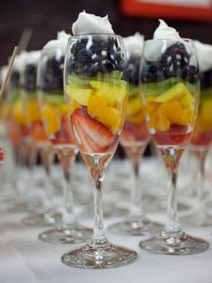 Delicious fruit with whip cream in a champaign glass...