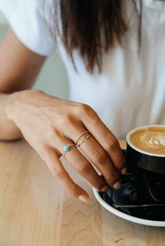 Mejuri fine rings in 14k solid gold with a pop chain ring with a turquoise stone.