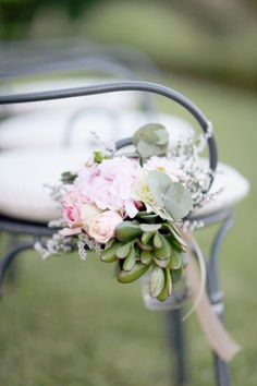 small bouquet of florals strung from the ceremony chairs