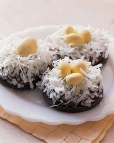 These thin chocolate cookies with ganache icing dipped into grated coconut make the perfect nests for two or three miniature chocolate eggs.