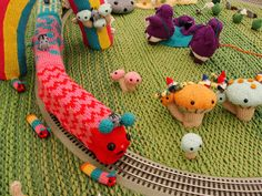 I WANT THIS! instead of a train it's a caterpillar and it rides under a rainbow!!!!!!!