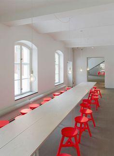 No Picnic studio boardroom. Love those orange stools!