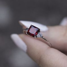 An elegant classic vintage style ring featuring a deep red square cut Ruby with two triangle Cubic Zirconia crystals. Sterling Silver. Ruby gemstone measures 6mm. #regalrose #ruby #vintage