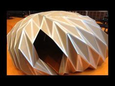 Pop-Up Dome Protoype  by Leon Zondervan and Dwayne van Halewijn of the cardboard prototype Pop-up Dome. It's a lightweight structure made out of corrugated cardboard sheets, connected with fiberglass reinforced tape. This prototype is a 2,5 meters high dome with a diameter of 5 meters, foldable (with a single rotating movement) into a transportable packa...