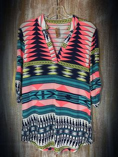 The Bling Box - Neon Tribal Roll Tab Top - Each Shirt is slightly different, $36.99 (http://www.theblingboxonline.com/neon-tribal-roll-tab-top-each-shirt-is-slightly-different/)