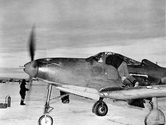 A Bell P-39L-1-BE Airacobra (USAAF s/n 42-4673?) at Nome Alaska (USA) in 1943-44. The red Soviet stars under the wings identify this as a lend-lease aircraft ferried to the USSR via Alaska.
