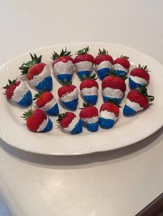 Dip strawberries halfway in whipped cream.  Next, dip just the tips in blue sugar sprinkles.  Serve and enjoy!  Happy Independence Day, America!
