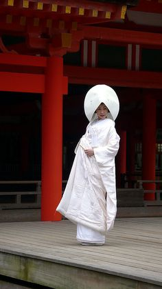Japanese bride - traditional Shinto wedding kimono, the hood is worn before and during the ceremony and than removed to reveal the headband and traditional hairstyle and ornaments