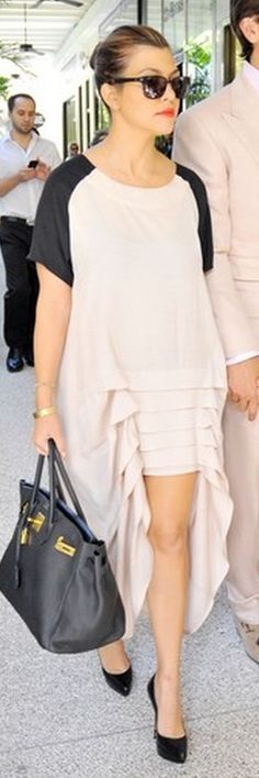 Kourtney Kardashian: Purse – Hermes    Shoes – Yves Saint Laurent    Dress – Cameo    Sunglasses – Balenciaga    Bracelet – Cartier