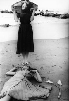 """…a woman apparently dead at the lip of the ocean, reflected in the mirror of another woman whose own face is displaced by that very mirror.""     Photo by    Francesca Woodman    April 3, 1958 - January 19, 1981"