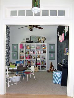 this is such a neat playroom - love the chalkboard wall, cube storage and vaulted ceiling