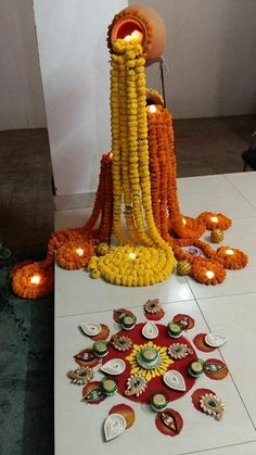 Welcome the Lord of Prosperity with a lovely flower and diya arrangement at the doorstep.
