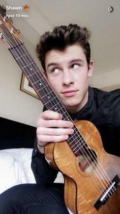 Shawn has a cute ukulele