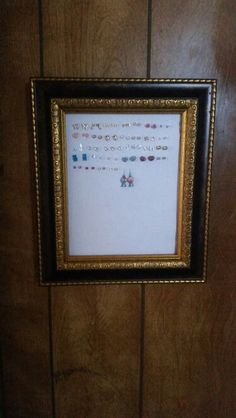 Made an earring holder for my daughter using a picture frame, cross stitch fabric and hinges for easy access