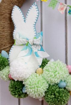 An adorable Spring Pom Pom Wreath tutorial that is sure to bring spring into your home this season. Diy Spring Wreath, Diy Wreath, Wreath Making, Wreath Ideas, Pom Pom Wreath, Pom Poms, Monogram Wreath, Easter Wreaths, Easter Crafts