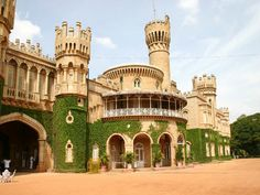 Bangalore Palace, a palace located in the city of Bangalore, India is modelled on the lines of the Windsor Castle in England. The Bangalore Palace flaunts Forest Department, Vertical Garden Design, Castles In England, Bangalore India, Visit India, Adventure Activities, Windsor Castle, Beautiful Sites, Tourist Places