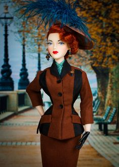 The Studio Commissary:  Friday Fall Favorite (theme photo)  -  Posted by Tom in CA [Email User] on October 6, 2017, 7:04 pm.  This is a D.A.E. suit in rust wool and black silk faille. The hat is iridescent rust silk dupioni trimmed in Capri blue ostrich feathers, because why not?  Hair by Ilaria.  Enjoy!    Tom in CA