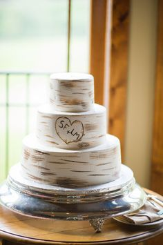 """love the initials and simplicity of how they """"smeared"""" (technical cake word) the frosting around the cake"""
