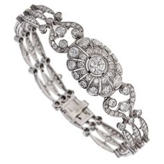 Edwardian Diamond Platinum Bracelet. The platinum bracelet contains approximately 10 carats of bead and bezel-set old European-cut and single-cut diamonds, color: H-I, clarity: VS2 - SI1. The bracelet measures 6 3/4 inches long.