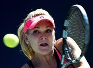 Agnieszka Radwanska of Poland returns the ball against Sara Errani of Italy during the quarter final of the Rogers Cup women's tennis tournament Friday, Aug. 9, 2013, in Toronto. (AP Photo/The Canadian Press, Nathan Denette)