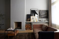 Nice mantle. Like the dark rug. Comfy leather couch.