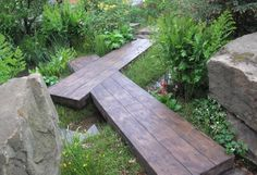 Wood plank paths intersect the garden crossing near the lower moon-gazing pool. Pearson said he wanted to encourage people to look at and discover the garden from several angles.
