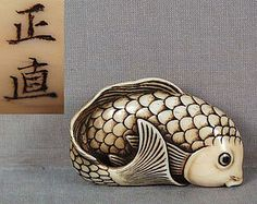 SWIMMING CARP by MASANAO // 19th century fine ivory netsuke of a swimming carp with its tail turned to the right and joining the pelvic and pectoral fins for compactness. Excellent rendition of pleasantly thick body, great carving of its scales and face, eyes are inlaid with dark horn. Very beautiful ink highlights, old age lines, superb patina. Signed MASANAO (for Masanao of Ise) on its cheek on the back