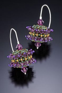 Crystal EarringsGlass beads are interwoven one-at-a-time over hand-dyed wooden orbs and embellished with amethyst Swarovsky crystals. Sterling silver earwires are hand-formed.