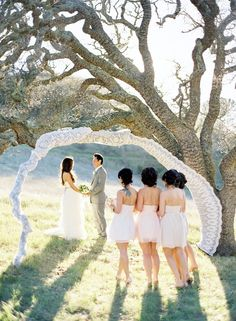 What a wonderful idea. The white lace border perfectly the ceremony space. It's simple to DIY as well. A basic tree curve can always be extended with props which can be hidden under the lace.