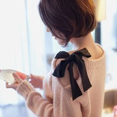 "Cute! Take an old sweater. Cut a slit in along the shoulder down about 7"". Fold over raw edge and sew in place. Sew a piece of ribbon about 15"" long to one side of neckline and another ribbon to the other side of the neckline. Tie together!"