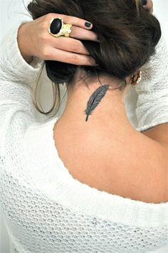 Little nape tattoo of a feather.