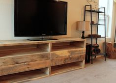 Reclaimed Wood Media Console / Entertainment Center. $1,244.00, via Etsy.
