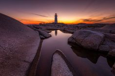 This was taken just before the light fades at the historic lighthouse of Peggy's Cove. A great day to see the scenery and admire the beautiful coastal shores of Nova Scotia.