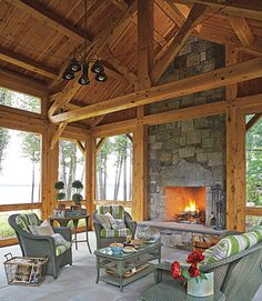 The Screened Porch houses a multi-season sitting area and dining nook, a perfect gathering spot. Porch Fireplace, Slate Fireplace, Outdoor Living Rooms, Outdoor Spaces, Outdoor Patios, Interior Architecture, Interior Design, New England Homes, Dining Nook